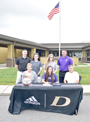 Dresden Lady Lion Rachel Childress signs with Bethel University basketball. Pictured are (L to R): Seated — Rachel's mom, Becky Childress; Rachel; and her dad, John Childress; Standing — Dresden Head Coach Jonathan West, Rachel's sisters Kristen and Kelly Childress; and Bethel Head Coach Chris Nelson. Photo by Brad Sam/The Banner