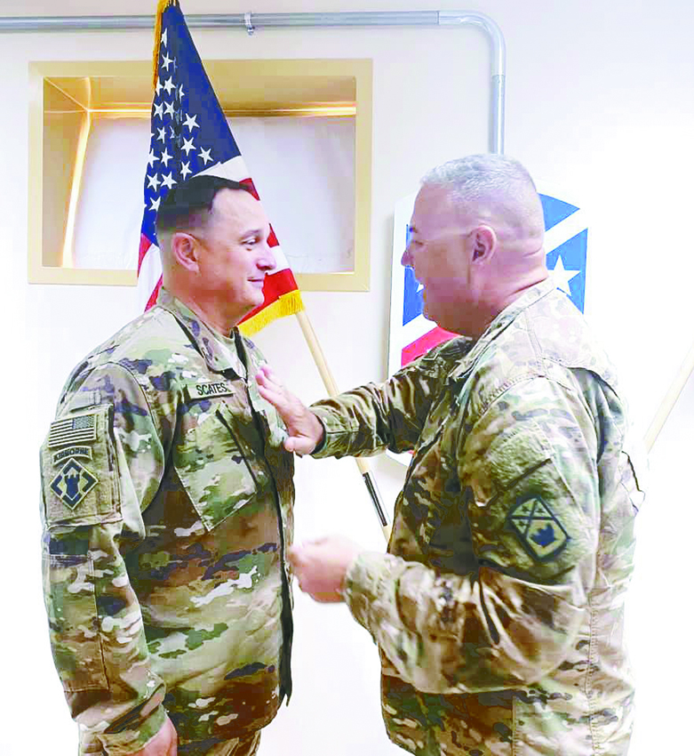 GREENFIELD (May 13) — Lt. Col. Trent Scates of Greenfield (left) received a promotion to the rank of colonel recently by 194th Engineer Brigade Commander Col. Ross Warner, while stationed in the Middle East as a member of the Tennessee Army National Guard.