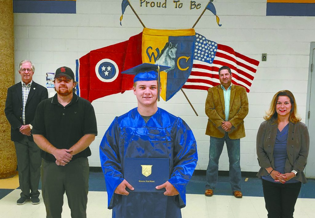 SOCIALLY DISTANCED RECOGNITION — Mason Whitten was scheduled to be in boot camp in South Carolina when his fellow members of Westview's Class of 2020 receive their diplomas on the weekend of June 12. To ensure that he got the opportunity to don the cap and gown, Principal Jeromy Davidson invited the Marine recruit and his family to a brief photo shoot on campus and included Weakley County School Board members Steve Vantrease and John Hatler. Seen in the socially distanced photo are front Mason Whitten, father Lance Whitten, mother Amy McCord, Vantrease and Hatler.