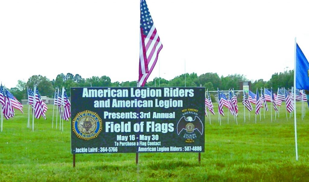 Members of American Legion Post #55 Riders placed American Flags along University Street in Martin in honor of Weakley County military personnel.