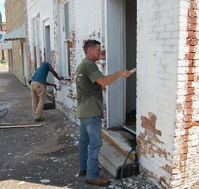 Renovations are underway at a former rental house, located at 109 South Wilson St. in downtown Dresden. The property is owned by Jim and Traci Crawford. Mr. Crawford, who operates a mechanical contracting company, had his sub-contractors assist him in making repairs to the structure. Crawford and employee Pedro Becerra are seen scraping paint off the brick in preparation for repainting.