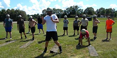 Due to the global coronavirus pandemic, high school football teams have eliminated scrimmages and contact practices. Players, such as those on the Dresden High School football team, are conditioning in preparation for the season.