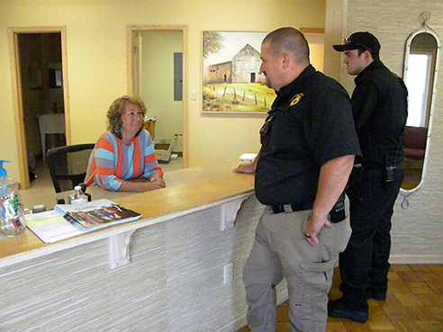 (L to R) City Recorder Donna Stricklin, Sharon Police Chief Troy Whitworth, and police officer Dillon Edwards gather at the new Sharon city hall lobby, located on Highway 45. Photo by Jasmine Williams/The Enterprise
