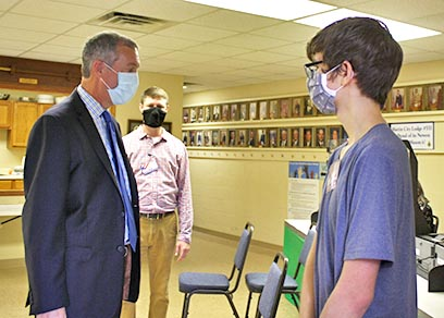 Tennessee Secretary of State Tre Hargett (left) visited the Martin City Masonic Lodge satellite early voting location Thursday, July 30, where he met with poll worker Conner Page, 18, (right) and Weakley County Administrator of Elections Alex Britt.