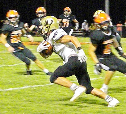 Dresden Lion Tristan Jett dodges Greenfield's defense for a first down during the match up between the teams Friday night.
