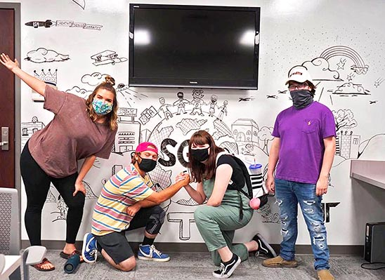 Members of the League of Striving Artists recently completed a mural on the campus of UT Martin as part of their give back to the campus community. (L to R) Brandy Gaul, Isaiah Kennedy, Daphne LaGrone and Grayson Buchinani.