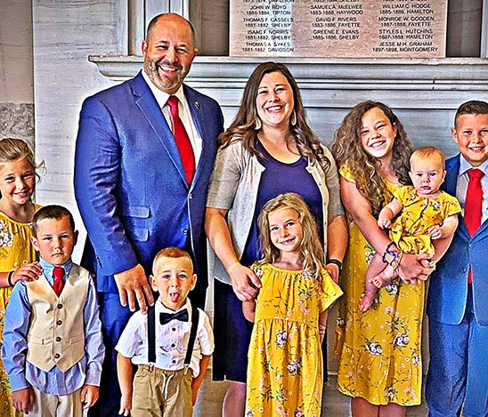 State Representative Andy Holt (R) is pictured with his wife, Ellie, and their seven children (left to right): Libby, Sammy, Anderson, Martha Ann, Josie (holding Lottie) and Andrew.