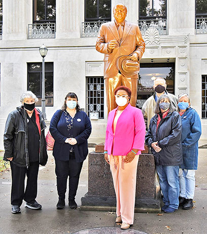 Members of the Weakley County Democratic Party joined U.S. Senate candidate Marquita Bradshaw (Front) in front of the late Governor Ned Ray McWherter's statue on the courthouse square on the day of McWherter's birthday last week.
