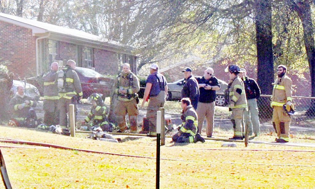 Firefighers extinguish a blaze inside a Martin housing Complex Wednesday afternoon.