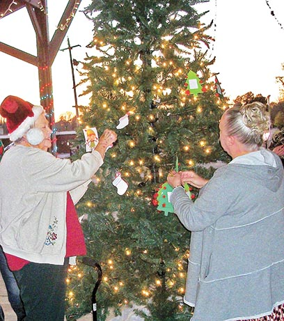 Local citizens placed cards on the Christmas Wishing Tree at Dresden Farmers Market on Tuesday, November 17, listing the Christmas wishes of needy youngsters from all across Weakley County. Each card removed from the tree was a promise to fulfill the Christmas wish of a local child.