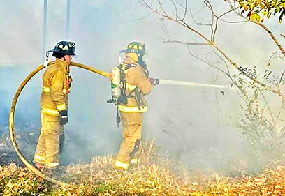 The Sharon Fire Department responded to a grass fire Thursday afternoon on Mt. Vernon Road, which threatened a nearby residence. They saved the home, but an outbuilding was gutted by the blaze.