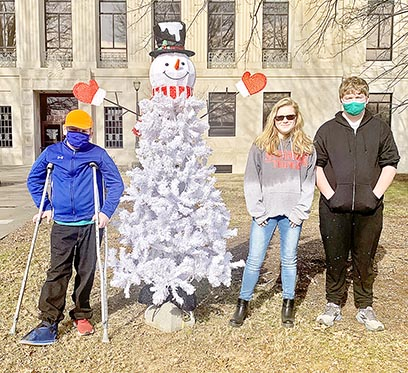 "Three children from the community came out this week to create a snowman tree on the lawn of the courthouse in downtown Dresden. (L to R) Siblings Greylon, Gabrielle and Gavin Price built a snowman using a Christmas tree and decorations as part of the city's first-ever ""Do You Wanna Build a Snowman"" event."