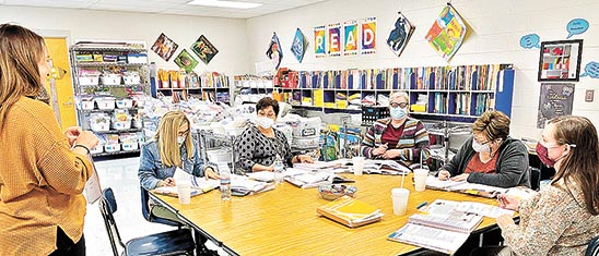 Jessica Glasgow, Weakley County's RTI Coordinator, is modeling training for Dresden Elementary's literacy leader Honey Cantrell (not seen) with (L to R) second-grade teachers Carla Hutcherson, Robin Higdon, Sherry Hatchel, Jennifer McClain, and Kristy Jolley.