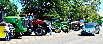 "Weakley County farmers and their equipment lined the funeral procession of former Commissioner of Agriculture and Dresden native Terry Oliver after the ""friend to agriculture"" died July 4, 2020."