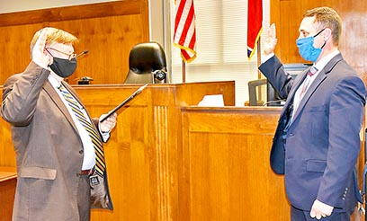 Weakley County General Sessions Judge Tommy Moore (L to R) swore in Dresden native James Washburn Tuesday, December 29 making Washburn the newest member of the Weakley County Bar.