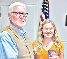 Gleason High School freshman Brooklyn McDowell, daughter of Lindsay and Jonathan McDowell, led the audience in reciting the Pledge of Allegiance during Monday night's Gleason City Board meeting. Mayor Charles Anderson presented McDowell with a copy of the Declaration of Independence and U.S. Constitution, in recognition of her good citizenship.
