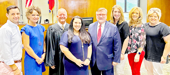 Weakley County officials in attendance at Thursdays swearing in ceremony for new Circuit Court Clerk Courtney McMinn included (left to right: County Mayor Jake Bynum; Clerk and Master Regina VanCleave; Circuit Court Judge Jeff Parham; Circuit Court Clerk Courtney McMinn; General Sessions Judge Tommy Moore; County Trustee Marci Floyd; County Clerk Kim Hughey; and Register of Deeds April Wright Jones. (photo: Kirsty-Rhe Janse)
