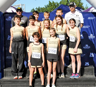 The Dresden Middle School cross country team and coaches Todd Maxey and Kenneth Corker gathered in Memphis for a state qualifying race. Photo courtesy of Kenneth Coker