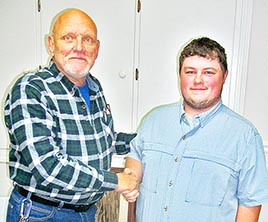 Water Department Superintendent Tony Terrell welcomes Clay Wright as an apprentice water superintendent during Monday night's Gleason Board meeting.